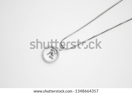 silver pendant with a letter, silver pendant with a stone, silver pendant with a bird, women's silver pendant on a white background