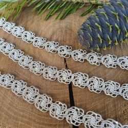 Silver product. Bracelet or chain. Made by hand. Sterling Silver 925. Original weaving. For an online store, a photo of silver.
