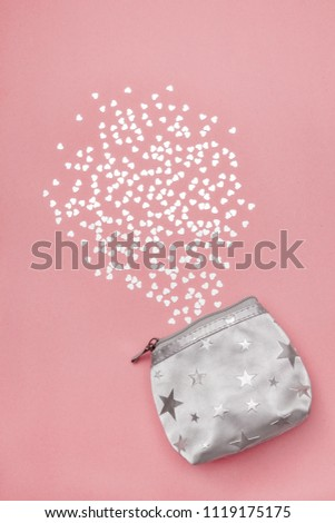 Silver purse and shiny hearts, on pastel pink background. #1119175175