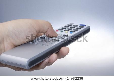Silver remote control in hand