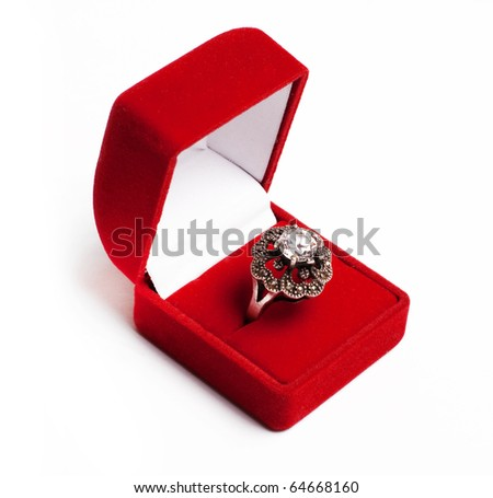 silver ring with brilliant in red box isolated on a white
