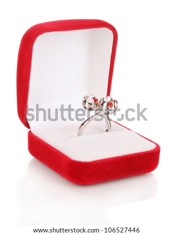 Silver ring with red, pink and clear crystals in red velvet box isolated on white