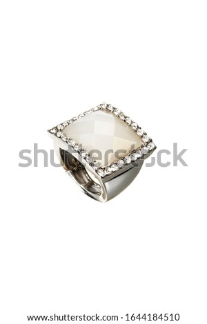 Silver ring with white stone on white background