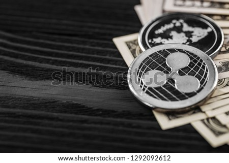 silver ripple coins xrp on a black wood background #1292092612