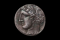 Silver 5 shekel Carthaginian coin replica with portrait of Tanit the sky goddess and the winged horse Pegasus on the reverse from the First Punic War 264-260 BC cut out isolated on a black background