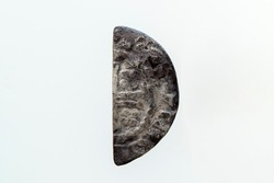 Silver short cross cut half penny English hammered coin of King Henry II of the 12th century dated around 1180- 1189  minted in London England isolated on a white background, stock photo image