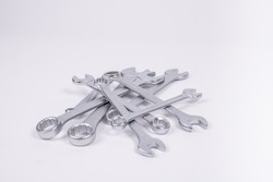 Silver spanners on white background. Garage tools isolated.