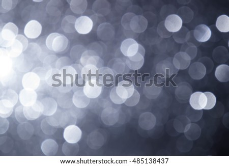 silver Sparkling Lights Festive background with texture. Abstract Christmas twinkled bright  bokeh defocused and Falling stars. Winter . Card or invitation. #485138437