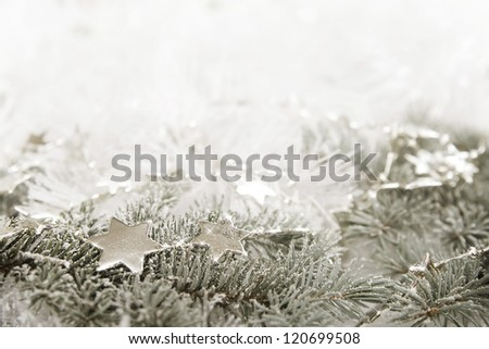 Silver sparkling stars on a white glistening background