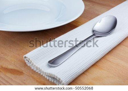 Silver spoon arranged on a wooden table