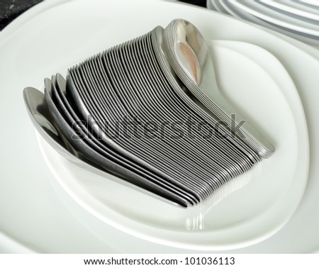 Silver Spoons on white dish
