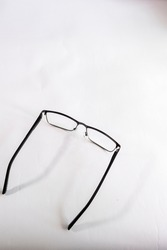 Silver sports goggles and handles are gray rubber on a white background and in the photo from above