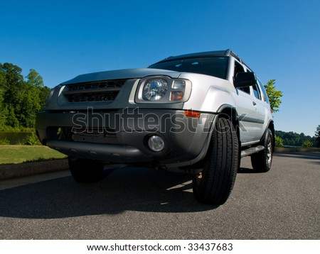 Silver Sports Utility Vehicle low angle view SUV