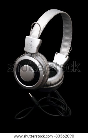 Silver stereo headphones isolated on black background