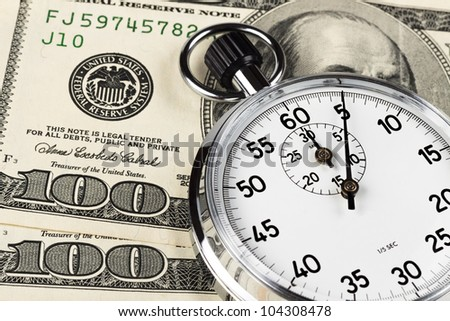 silver stopwatch closeup 5 sec on two hundred dollar bills