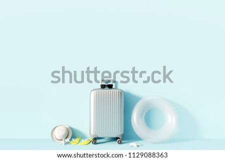 Silver suitcase and beach accessories with sunlight on pastel blue background. summer travel concept. 3d render
