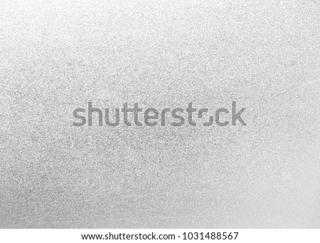Silver texture foil metal background. Metallic holiday christmas light shine gray backdrop with paper sparkle abstract.