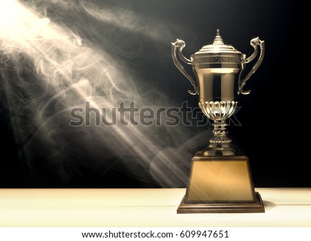 silver trophy placed on wooden table with dark background copy space ready for your design win concept.