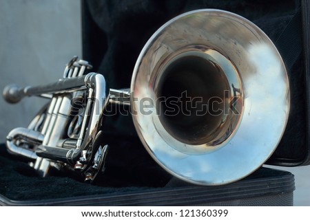 Silver trumpet in the black box