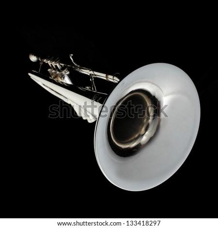 Silver trumpet on  dark background - stock photo