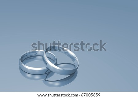 stock photo Silver wedding bands on a grey background