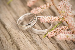 Silver wedding rings on a wooden  background