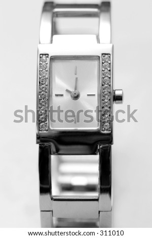Silver wrist watch encrusted with diamonds