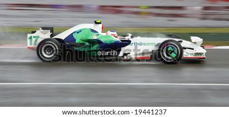 Silverstone, England - July 6: Rubens Barrichello races in the 2008 British Santanda Silverstone F1 Grand Prix in his Honda RA108 on July 6th, 2008