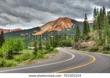 Shutterstock Silverton, Colorado - a motorcyclist travels along the Million Dollar Highway in southwest Colorado through the La Plata Mountains (Rocky Mountains)