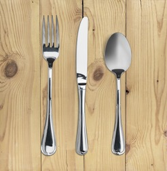 Silverware. Fork, spoon and knife on the desk