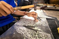 Silverware making. Thai craftman are making silverware. The original of the silver craftsmen on Wua Lai road, Chiang Mai. Thailand.
