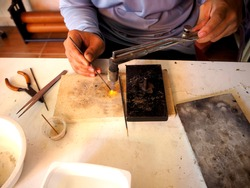 Silverware manufacturer Silverware making. Craftsman are making silverware.The original of the silver craftsmen at Thailand.