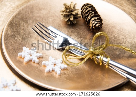 silverware on a golden plate