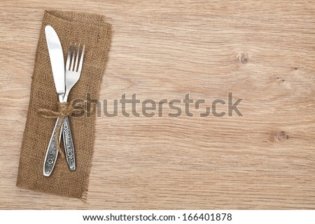 Silverware or flatware set of fork and knife on wooden table