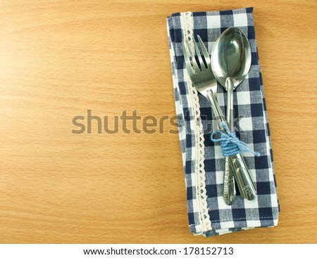 Silverware or flatware set of fork and spoon on wooden table
