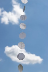 silvery circles as a decoration against the sky