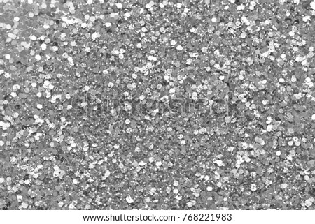 Silvery Soft Blurred Boke Background. Abstract Circles of Christmaslight. Spangles and Shiny Silver Color Background. Bright Background. Glamorous background for your design and decoration.