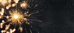 Silvester background banner panorama long- firework and sparklers on dark black night texture, with space for text