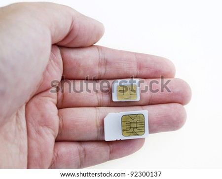 Sim and micro-sim card In a hand isolated on white background.