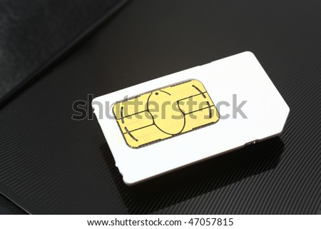 sim card on a black metal background