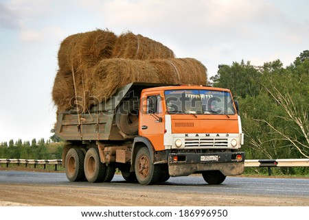 SIM, RUSSIA - AUGUST 21, 2008: Orange KAMAZ 55111 hay carrier at the interurban road.