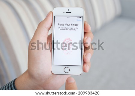 Simferopol, Russia - July 14, 2014: Touch ID the scanner of fingerprints developed by Apple corporation. Allows users to unblock the smartphone and to make purchases.