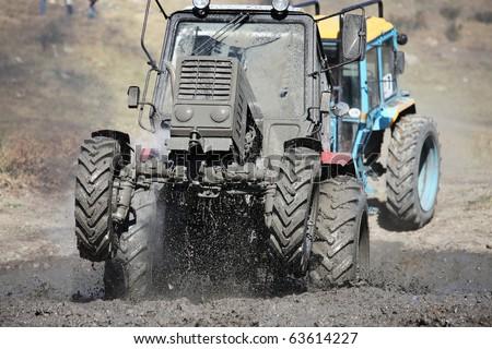 SIMFEROPOL, UKRAINE - SEPT 4: International Tractor Racing was held in the vicinity of Simferopol town at Crimea Peninsula, Ukraine - September 4, 2010. Tractor driver - Anatoliy Bobrovskiy