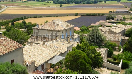 Simiane la Rotonde, charming old village in Provence, view on typical provencal houses with lavender fields at background, Provence, France, Europe, picture taken during lavender season in summer