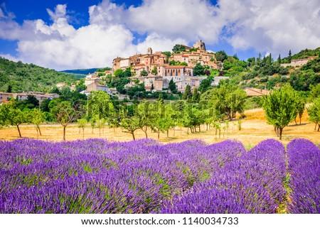 Simiane-la-Rotonde, hilltop village in Provence with lavender fields, France.