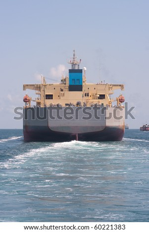 simmetric rear view of a oil tanker and his wake