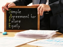 Simple agreement for future equity SAFE is shown on the photo