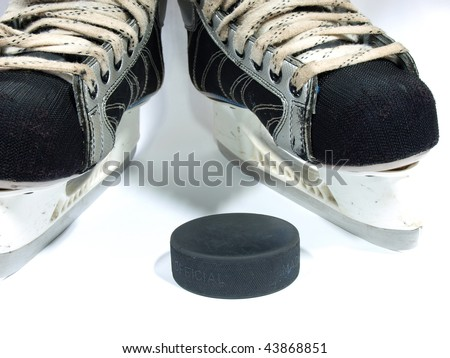 Simple amateur hockey skates and the puck