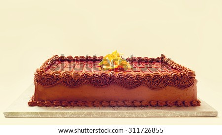 Simple and classical chocolate cake on white background. Details of cream and sugar decoration.