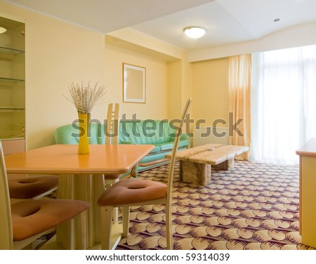 simple apartment room with colorful furniture